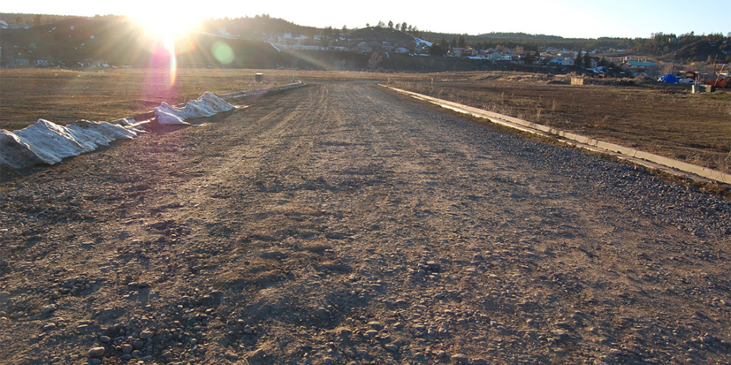 A un-improved gravel road leads onto the 27-acre parcel owned by the Springs Partners LLC. Owners Matt Mees and Bill Dawson thought they had sold the property to the Whittington family in 2005, but the Whittingtons handed the parcel back to them in 2012. Mees and Dawson now claim to need Town taxpayers to build them a bridge onto the property.