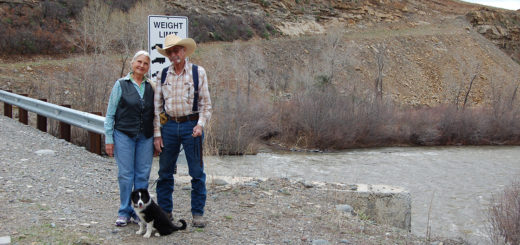 """Lee and Jac Constant, beside their new bridge across the San Juan River.  The bridge has created access to a deposit of """"superior"""" gravel."""
